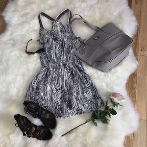 Ya Los Angeles zebra print zipper strap dress.